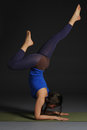Young beautiful healthy yoga woman instructor doing yoga in photo studio Royalty Free Stock Photography
