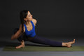 Young beautiful healthy yoga woman instructor doing yoga in photo studio Royalty Free Stock Images