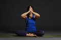 Young beautiful healthy yoga woman instructor doing yoga in photo studio Royalty Free Stock Photos