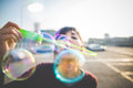 Young beautiful hipster woman bubble blower in the city Royalty Free Stock Image