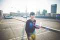 Young beautiful hipster woman bubble blower in the city Stock Photo