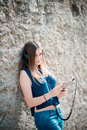 Young beautiful hipster woman listening music to with headphones in the city Royalty Free Stock Images