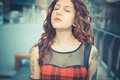 Young beautiful hipster woman with red curly hair in the city Royalty Free Stock Images