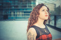 Young beautiful hipster woman with red curly hair in the city Stock Images