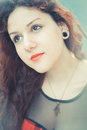 Young beautiful hipster woman with red curly hair in the city Royalty Free Stock Image
