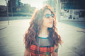 Young beautiful hipster woman with red curly hair in the city Stock Image