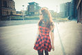 Young beautiful hipster woman with red curly hair in the city Stock Photography