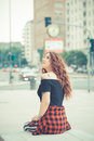 Young beautiful hipster woman with red curly hair in the city Stock Photos