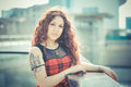 Young beautiful hipster woman with red curly hair in the city Royalty Free Stock Photo