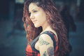 Young beautiful hipster woman with red curly hair in the city Royalty Free Stock Photos