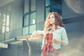 Young beautiful hipster woman with red curly hair listening music in the city Stock Image