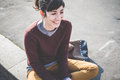 Young beautiful hipster woman using smart phone in the city Royalty Free Stock Photos