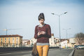 Young beautiful hipster woman using smart phone in the city Royalty Free Stock Image