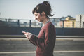 Young beautiful hipster woman using smart phone in the city Royalty Free Stock Photography