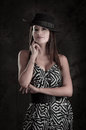 Young beautiful lady in dress wearing a hat looking at camera this image has attached release Royalty Free Stock Photography