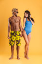 Young beautiful loving couple in beachwear holding hands Royalty Free Stock Photo