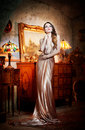 Young beautiful luxurious woman in long elegant dress a classic interior seductive brunette Stock Image