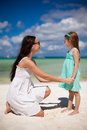 Young beautiful mother and her adorable little daughter at tropical beach Royalty Free Stock Photos