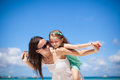 Young beautiful mother and her adorable little daughter at tropical beach this image has attached release Stock Photo