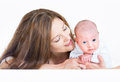 Young beautiful mother playing with her newborn baby laying on h his tummy Stock Photos