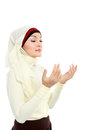 Young beautiful muslim woman in scarf praying Stock Photography