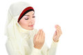 Young beautiful muslim woman in scarf praying isolated over white background Stock Photos