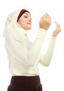 Young beautiful muslim woman in scarf praying to god Royalty Free Stock Images