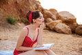 Young beautiful pensive pin up girl sitting with book Royalty Free Stock Photo