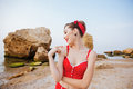Young beautiful pin up girl in red swimsuit posing Royalty Free Stock Photo