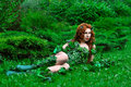 Young beautiful red-haired girl in the image of the comic book poison ivy Royalty Free Stock Photo
