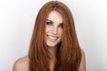 Young beautiful redhead woman with gorgeous hair and violet eyes makeup smiling Royalty Free Stock Photo