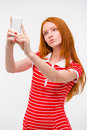 Young beautiful redhead woman  taking selfie and making duck face Royalty Free Stock Photo