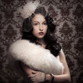 Young beautiful retro lady in fur Royalty Free Stock Photography