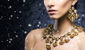 Young, beautiful and rich woman in jewels Royalty Free Stock Photo