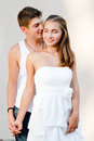 Young beautiful romantic couple men women embracing each other tenderly playfully Stock Images