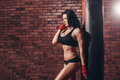 Young beautiful sexy boxer woman with red boxing Royalty Free Stock Photo