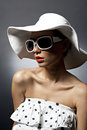 Young beautiful sexy woman with hat and sunglasses. Red lipskick Stock Images
