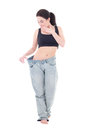Young beautiful slim excited woman in big jeans with isolated on Royalty Free Stock Images