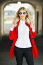 Young beautiful slim girl posing and wearing sunglasses Stock Photo