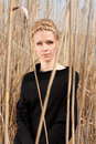 Young beautiful slim girl in the reed Royalty Free Stock Photos