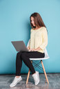 Young beautiful smart girl using laptop pc computer for study Royalty Free Stock Photo