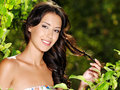 Young beautiful smiling woman outdoors Royalty Free Stock Image
