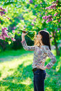 Young beautiful smiling woman smells small bouquet Royalty Free Stock Photo