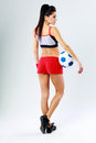 Young beautiful sport woman standing with soccer ball Royalty Free Stock Photo
