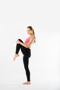 Young beautiful sports girl does fitness exercise stretching on white background Royalty Free Stock Photo