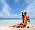 Young, beautiful, sporty and sexy woman relaxing on the beach Royalty Free Stock Photo
