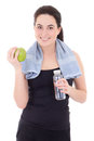 Young beautiful sporty woman with bottle of mineral water and ap Stock Photography