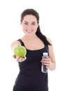 Young beautiful sporty woman with bottle of water and apple isol isolated on white background Royalty Free Stock Photo