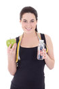 Young beautiful sporty woman with bottle of water, apple and mea Royalty Free Stock Photos