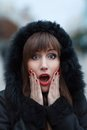 Young beautiful surprised girl at winter outdoor amazed woman Royalty Free Stock Images